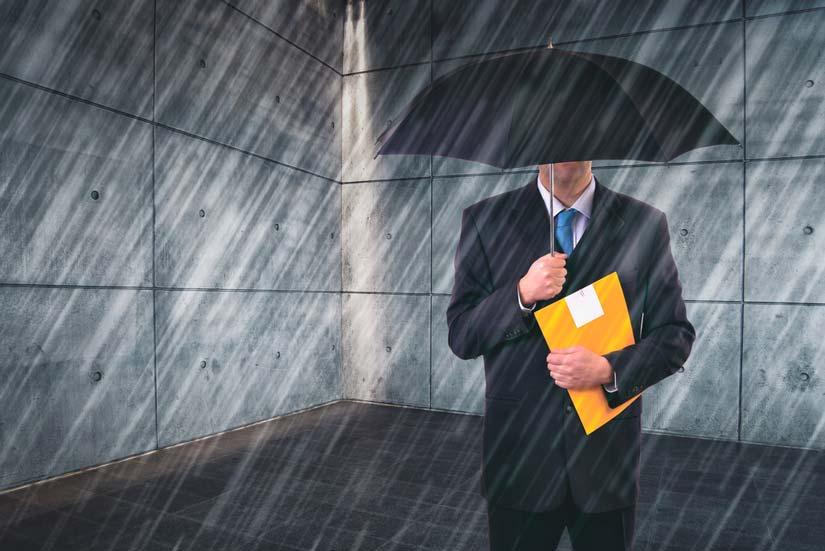 Employee under umbrella