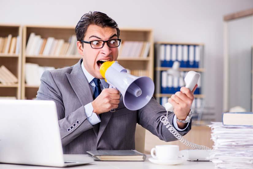 Bad boss at desk yelling